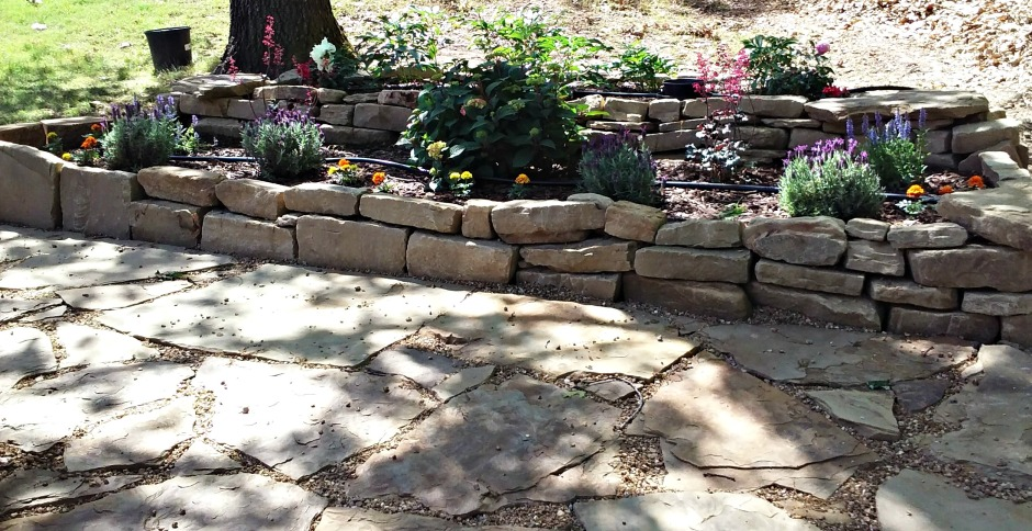 rock walkway and raised garden