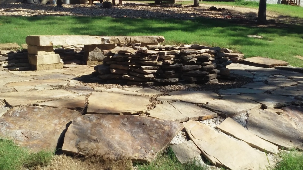 native stone fire pit and sitting area