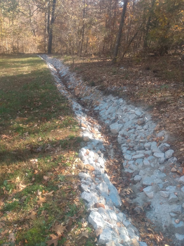long local stone drainage ditch